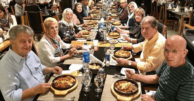 Tourists in Haft Khan Restaurant Complex