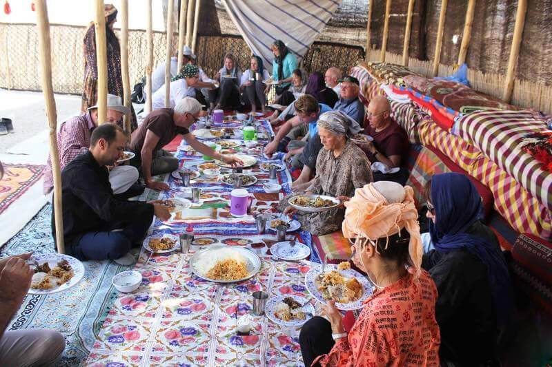Tourist are eating Iranian nomad 's food